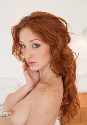 Freckled redhead Michelle H in silk lingerie spreads legs and pussy