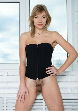 Slender girl Eddison showing off furry underarms and hairy pussy