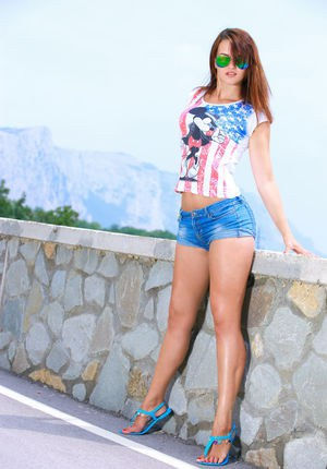 Natural redhead Mesed A in glasses  shorts gets naked outdoors baring hot ass
