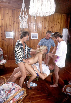 Slutty blonde Nadine gets double penetration while sucking in vintage groupsex
