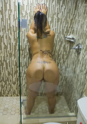 Chubby Latina babe Briana Lee enjoys fingering her twat in the shower