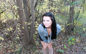 Erotic amateur Freckles teases in the woods wearing a white thong and boots