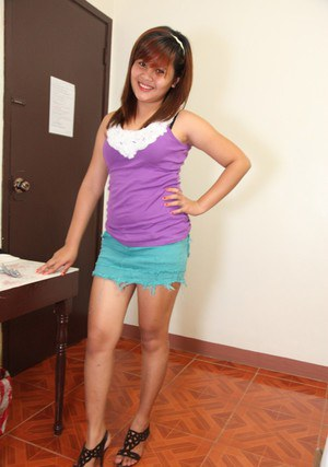 Cut Filipina girl takes off her skirt and clothes to display her trimmed bush