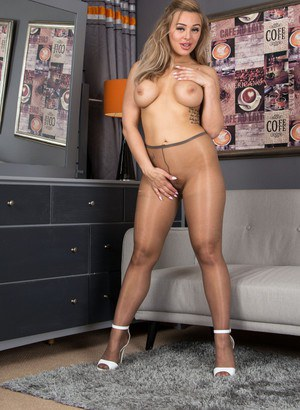Happy young Beth Bennett gladly shows of her naked twat in sheer pantyhose