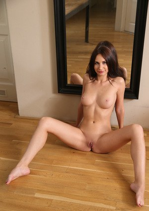 College girl Lana Ray admires her beautiful bod while disrobing afore a mirror