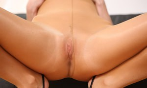 Caucasian solo girl shows her yummy pussy as she pulls down her pantyhose