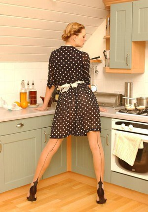 Solo model Joceline Brook Hamilton makes a mess while eating a tart in kitchen