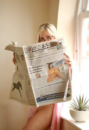 Hot blonde chick with nice tits gets dressed before reading the paper
