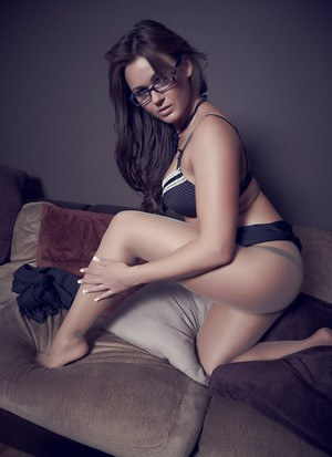 Glamour model Kat Dee blows a kiss wearing pantyhose and glasses