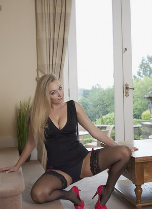 Blonde model Hayley Marie Coppin takes off her black dress and high heels