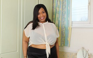 Fat black female from the UK unleashes her giant boobs in white fishnets