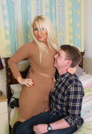 British housewife in over the knee leather boots spreads legs for young lover