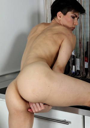 Short haired housewife Halle B masturbates with a leg up on kitchen counter