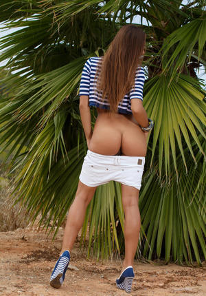 European Dominika A flashing hot ass & stripping shorts to pose nude on beach