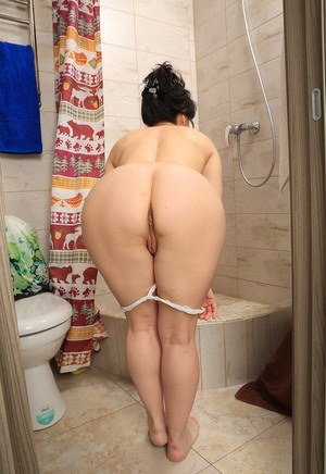 Brunette housewife Nataly lathers nice tits & sexy mature ass in the shower
