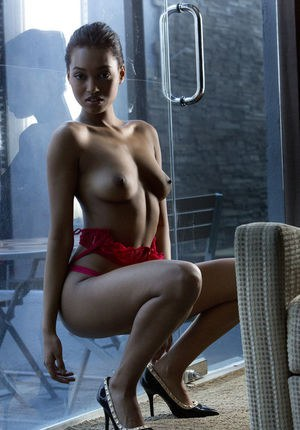 Black glamour model Noel Monique freeing girl parts from red lingerie