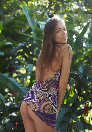 Sexy brunette cutie Dominika A strips out of her flimsy colorful dress