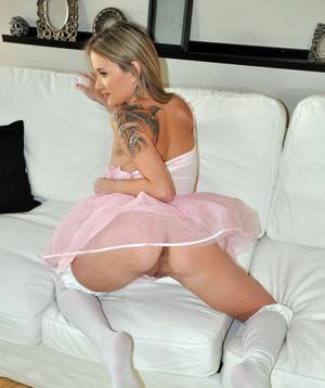 Attractive ballerina in provocative outfit plays with her juicy pussy