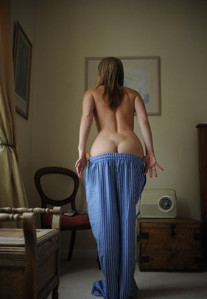 Sexy blonde girl Nikki Friend flaunts her bare tits in pajama bottoms