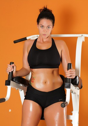 Brunette chick Alison Tyler whips out her hooters and pussy on fitness gear