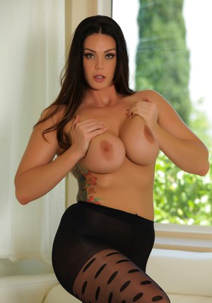 Hot solo model Alison Tyler goes topless by a window in sexy pantyhose