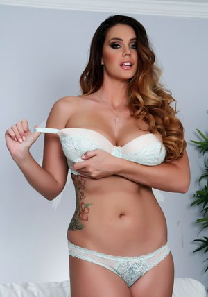 Chubby solo model Alison Tyler releases her big boobs from white brassiere