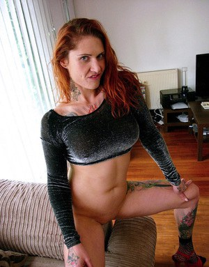 Hot redhead Tallulah Tease in socks and heels showing bald pussy & big tits