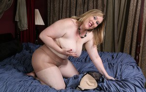 Horny mature wife in pantyhose enjoys flashing her sagging tits