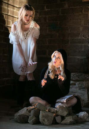 Fully clothed teens Dahlia Sky and Charlotte Stokely model in cosplay garb