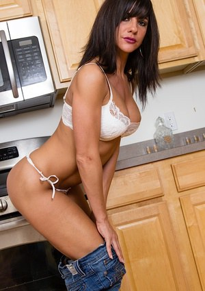 Hot brunette Mackenzie Marie strips off her jeans and then her white lingerie