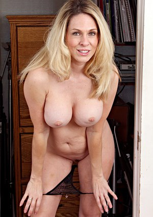 Middle-aged broad Angela Attison uncovers her big tits for the first time
