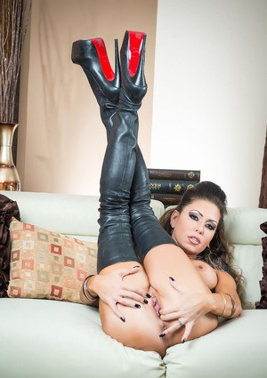 Fake titted MILF Jessica Jaymes wears thigh high boots to finger her tight ass