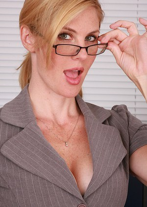 Horny blonde secretary Kate removes her glasses her clothing to spread at work