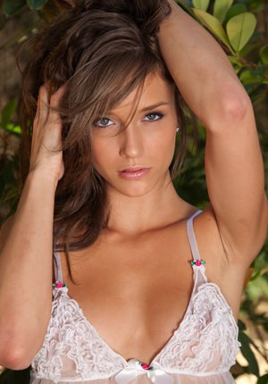 Brunette Malena Morgan in lace lingerie stripping to pose naked in the yard