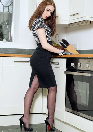 Sultry gloved beauty Astrid strips to her black stockings in the kitchen