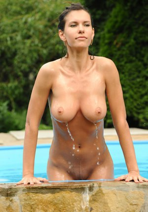 Hot busty glamour model Suzanna A showing hard nipples  wet pussy at the pool