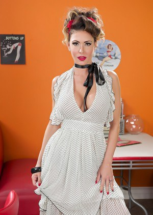 Pinup model Jessica Jaymes fingers her pussy in a 50s diner