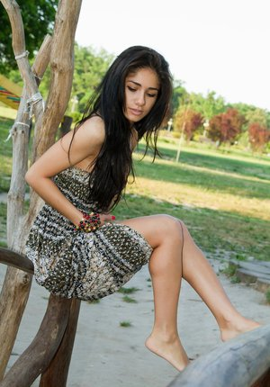 Dark haired petite teen Malina A flashes sexy no panty upskirt outdoors