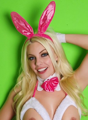 Hot blonde cosplay girl Britney Amber spreading pussy in pink bunny costume