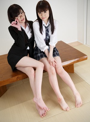 Japanese schoolgirls go pantiless while giving a footjob to a fuck buddy