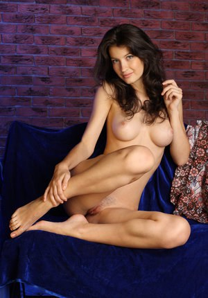 Pretty brunette Ganna A removing her clothing to flaunt her naked snatch