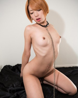 Japanese sex slave with red hair deepthroats a cock during messy oral sex