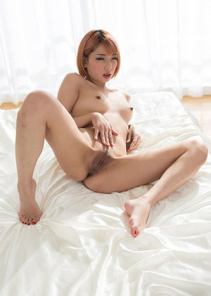 Naked Japanese lesbians rub their pussies together after finger fucking