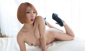 Tiny titted Japanese girls explore each others bodies with hands and tongues