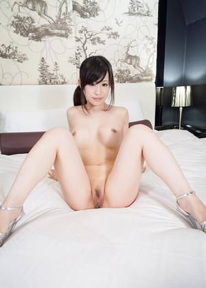 Japanese solo girl displays her neatly trimmed muff on her bed