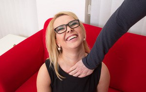 Clothed blonde in glasses, skirt and stockings get stripped of her clothing