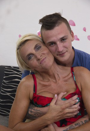 Short haired housewife finds her young boy toy's attention to be intoxicating