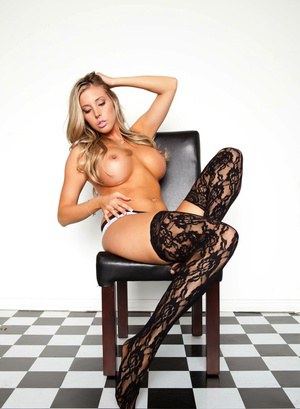 Sexy blonde MILF Samantha Saint in hot stockings shows off fine big breasts