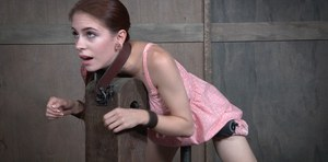 Restrained female Anna de Ville is spit roasted by a kinky couple