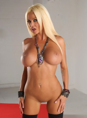 Hot blonde chick Nikita Von James rocks her huge boobs in black stockings